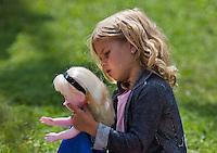 August 9, 2014, Netherlands, Rotterdam, TV Victoria, Tennis, National Junior Championships, NJK,  Girl plain with her doll<br /> Photo: Tennisimages/Henk Koster