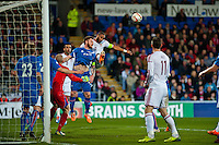 Wednesday 05 March 2014<br /> Pictured:Ashley Williams ( Centre orange boots )  jumps for the ball in the box<br /> Re: International friendly Wales v Iceland at the Cardiff City Stadium, Cardiff,Wales UK