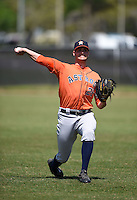Houston Astros minor league pitcher Mark Appel (26) warms up in the outfield before a spring training game against the Detroit Tigers on March 21, 2014 at Osceola County Stadium Complex in Kissimmee, Florida.  (Mike Janes/Four Seam Images)