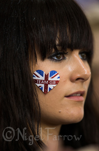 03 AUG 2012 - LONDON, GBR - Zoe Burke watches as her brother Steven Burke receives his gold medal after the Great Britain team won the Team Pursuit final at the London 2012 Olympic Games in the Olympic Park Velodrome in Stratford, London, Great Britain .(PHOTO (C) 2012 NIGEL FARROW)
