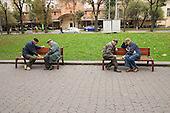 Elderly men play chequers in Prospekt Svobody in the centre of Lviv.