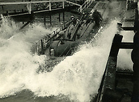 BNPS.co.uk (01202 558833)<br /> Pic: RNLI<br /> <br /> Slipway launch at Shoreham lifeboat.<br /> <br /> Splash in the Attic...<br /> <br /> A 'lost' cache of 13,000 photographs charting the history of the RNLI has been found in the attic of the charity's headquarters.<br /> <br /> Many of the black and white photos date back to the 1920s and '30s long before the terms 'health and safety' and 'risk assessment' were thought of.<br /> <br /> One image depicts a brave lifeboatman dressed in a suit and cloth cap just as the lifeboat he is on launches down a ramp into a choppy sea.<br /> <br /> Another shows the crew of another open lifeboat getting swamped by waves with only their souwesters and lifejackets to protect them.<br /> <br /> The photos have been unearthed in storage space at the RNLI HQ in Poole, Dorset, and they are now being digitised.