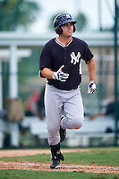 GCL Yankees East designated hitter Tim Lynch (59) runs to first during a game against the GCL Pirates on August 15, 2016 at the Pirate City in Bradenton, Florida.  GCL Pirates defeated GCL Yankees East 5-2.  (Mike Janes/Four Seam Images)