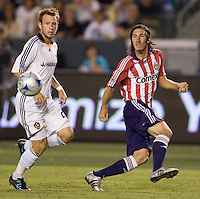 Chivas USA midfielder Sacha Kljestan (16) centers a ball past LA Galaxy midfielder Ely Allen (26) during a MLS game. Chivas USA and the LA Galaxy played to a  1-1 draw at Home Depot Center stadium, in Carson, California on Thursday, July 10, 2008.