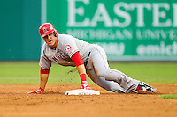 Mike Trout (27) of the Los Angeles Angels steals second base against the Detroit Tigers at Comerica Park on June 25, 2013 in Detroit, Michigan.  The Angels defeated the Tigers 14-8.  (Brian Westerholt/Four Seam Images)