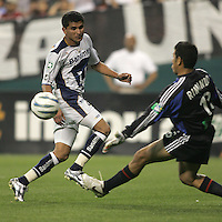 6 April 2005.  Pumas UNAM forward Joaquin Botero (9) crosses the ball past DC United goalkeeper Nick Rimando (18) during a CONCACAF Champion's Cup game at RFK Stadium in Washington, DC.