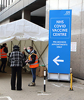 A steady stream of elderly people with pre-booked appointments at the new Covid-19 Vaccination hub at theOlympic Office Centre, near London's Wembley Stadium. <br /> It is one of 10 new large scale Vaccination centres open this week, to join the seven already in use across the country. So far 4.9 million people across the UK have received a first dose of vaccine and the government aims for that number to rise to 15 million by 15 February. Wembley, London on Thursday January 21st 2021<br /> <br /> Photo by Keith Mayhew