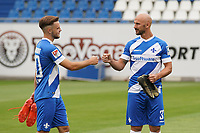 Adrian Stanilewicz (SV Darmstadt 98) und Patrick Herrmann (SV Darmstadt 98) begruessen sich - 27.08.2020: SV Darmstadt 98 Mannschaftsfoto, Stadion am Boellenfalltor, 2. Bundesliga, emonline, emspor<br /> <br /> DISCLAIMER: <br /> DFL regulations prohibit any use of photographs as image sequences and/or quasi-video.