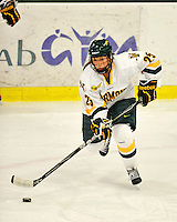 11 February 2011: University of Vermont Catamount defender Megan Dalbec, a Freshman from Champlin, MN, in action against the University of New Hampshire Wildcats at Gutterson Fieldhouse in Burlington, Vermont. The Lady Catamounts defeated the visiting Lady Wildcats 4-2 in Hockey East play. Mandatory Credit: Ed Wolfstein Photo