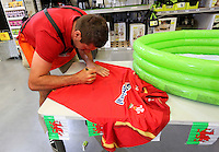 Justin Tipuric signs a Wales rugby top