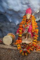 India, Dehradun.  Statue of Sai Baba of Shirdi, a Great Spiritual Master Revered by both Hindu and Muslim Devotees.  Died 1918.  Tapkeshwar Hindu Temple.