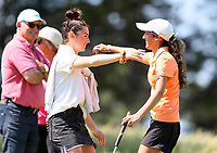 Tara Raj congratulated by Caitlin Maurice  after defeating Anna An during the New Zealand Amateur Golf Championship, Poverty Bay Golf Course, Awapuni Links, Gisborne, Saturday 24 October 2020. Photo: Simon Watts/www.bwmedia.co.nz