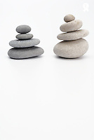 Two stacks of white and gray pebbles, studio (Licence this image exclusively with Getty: http://www.gettyimages.com/detail/82406684 )