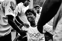 Zakir's trainers try to cool him down after he received a stiff strike at the Mohammad Ali national boxing stadium.