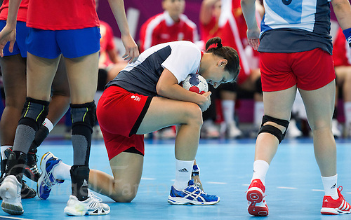 25 JUL 2012 - LONDON, GBR - Yvonne Leuthold (GBR) of Great Britain recovers from a challenge during the women's London 2012 Olympic Games warm up handball match against Spain at The Copper Box in the Olympic Park, in Stratford, London, Great Britain .(PHOTO (C) 2012 NIGEL FARROW)