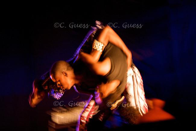 Two Tanzanian dancers participate in an interpretive dance piece during the Visa2Dance International Dance Festival held on October 25, 2008 in Dar Es Salaam, Tanzania.