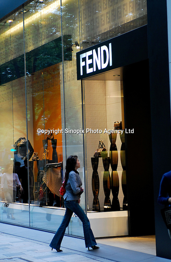 Shoppers walk past Fendi on Omotesando in the Harajuku area of Tokyo, Japan. As Japan is seeing the light after over ten years of a stagnant economy public consumer spending is on the increase with new shops and cafes opening and doing well..