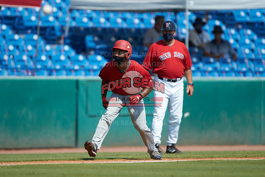 JuJu Stevens (47) of Amity Regional HS in Woodbridge, CT playing for the Boston Red Sox scout team takes his lead off of third base during the East Coast Pro Showcase at the Hoover Met Complex on August 5, 2020 in Hoover, AL. (Brian Westerholt/Four Seam Images)