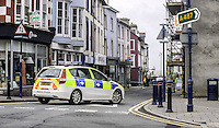 "WEATHER PICTURE WALES<br /> Pictured: The street that has been closed off by the police because of roof tiles coming off in Aberystwyth, Ceredigion, Wales. Wednesday 02 March 2016<br /> Re: Roads have been closed, homes left without power and tiles blown from roofs after Storm Jake brought wintry showers and high winds to Wales.<br /> Yellow Met Office ""be aware"" warnings of snow, ice and wind were issued for most of Wales for Wednesday morning.<br /> Gusts - forecast to reach up to 70mph - caused roof tiles to fall and trees to be blown over in Aberystwyth, with roads closed as a precaution."
