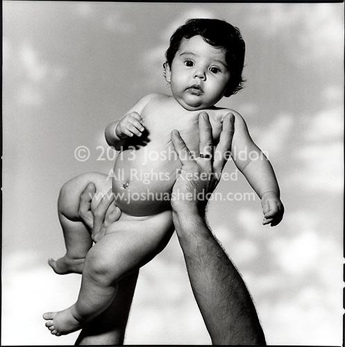 Baby girl held aloft<br />