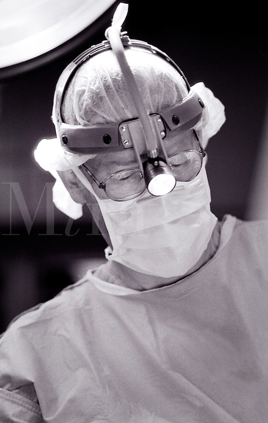 A physician at work in the operating room.