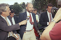 Jul 26, 1990 - Long Beach, California, USA - Former Exxon Valdez Capt. Joseph Hazelwood is surrounded by reporters as he leaves his relicensing hearing in Long Beach, Calif. on Wednesday, July 26, 1990. The Coast Guard suspended Hazelwood's captain's license for one year, with three of those months covered by a probation period. The Coast Guard dismissed two misconduct and negligence charges against him..(Credit Image: © Alan Greth)
