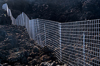 Wire fence in lava. Maui, Hawaii