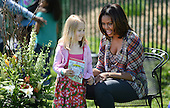 United States first lady Michelle Obama greets kids after reading a the story My Garden during the annual White House Easter Egg Roll on the South Lawn of the White House April 21, 2014 in Washington, DC. President Barack Obama and first lady Michelle Obama hosted thousands of people during the annual celebration of Easter. <br /> Credit: Olivier Douliery / Pool via CNP