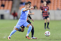 Houston, TX - Friday December 9, 2016: Nico Melo (31) of the North Carolina Tar Heels and Bryce Marion (7) of the Stanford Cardinal chase after a loose ball at the NCAA Men's Soccer Semifinals at BBVA Compass Stadium in Houston Texas.