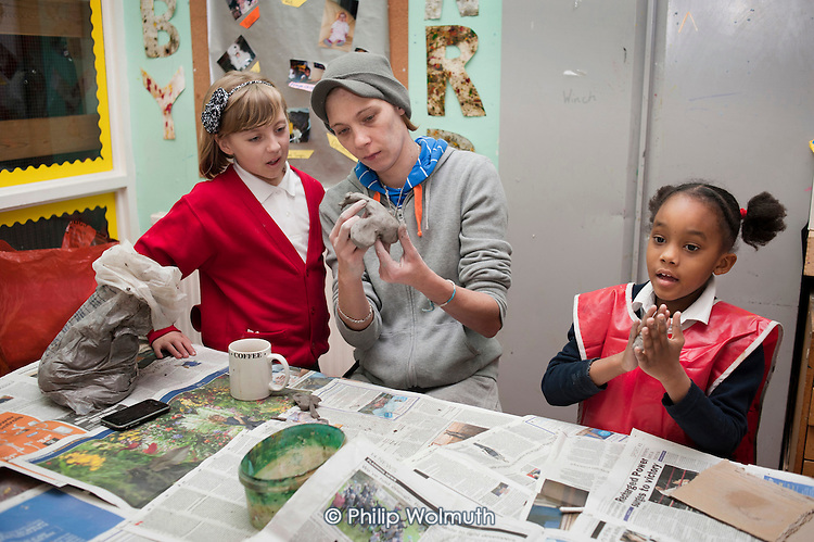 Working with clay at an after-school club at the Winchester Project, Swiss Cottage, which is threatened with closure following government cuts to Camden Council's funding.