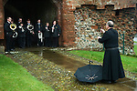 The Lady Anne Clifford Dole Ceremony Brougham Castle Cumbria 2016. The Rev Alan Maguire having taken a mobile phone photo of the members of the Penrith Town Band shows it to them
