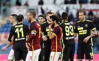 Calcio, Serie A: Roma vs Hellas Verona. Roma, stadio Olimpico, 17 gennaio 2016.<br /> Roma's Daniele De Rossi, left, and Mohamed Salah leave the pitch at the end of the Italian Serie A football match between Roma and Hellas Verona at Rome's Olympic stadium, 17 January 2016. The game ended 1-1.<br /> UPDATE IMAGES PRESS/Isabella Bonotto