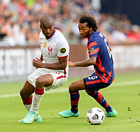 AUSTIN, TX - JULY 29: Gianluca Busio #6 of the United States and Abdelkarim Hassan #3 of Qatar chase after a loose ball during a game between Qatar and USMNT at Q2 Stadium on July 29, 2021 in Austin, Texas.