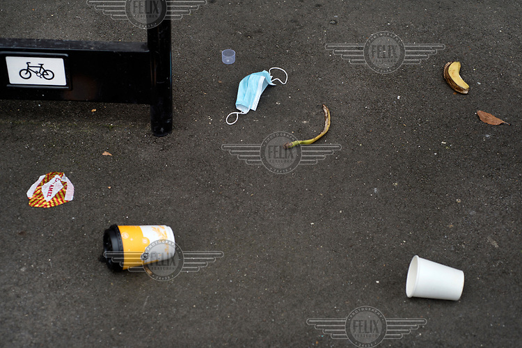A discarded face mask and other food waste on Bocking Street, LB Hackney.
