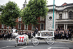 © Joel Goodman - 07973 332324 . 30/06/2017 . Stockport , UK . Martyn's coffin is taken from the Town Hall after the service . The funeral of Martyn Hett at Stockport Town Hall . Martyn Hett was 29 years old when he was one of 22 people killed on 22 May 2017 in a murderous terrorist bombing committed by Salman Abedi, after an Ariana Grande concert at the Manchester Arena . Photo credit : Joel Goodman