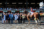 SARATOGA SPRINGS - AUGUST 27: Joe Bravo, aboard A.P. Indian #11, poses for a photo with the connections in the winner's circle after winning the Priority One Jets Forego Stakes on Travers Stakes Day at Saratoga Race Course on August 27, 2016 in Saratoga Springs, New York. (Photo by Sue Kawczynski/Eclipse Sportswire/Getty Images)