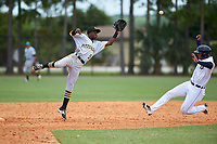 GCL Pirates second baseman Victor Ngoepe (5) jumps to catch a throw as Darwin Alvarado (24) slides in safely for a stolen base during a game against the GCL Tigers West on July 17, 2017 at TigerTown in Lakeland, Florida.  GCL Tigers West defeated the GCL Pirates 7-4.  (Mike Janes/Four Seam Images)