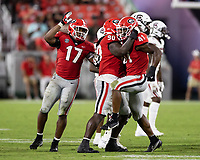 ATHENS, GA - SEPTEMBER 18: Nakobe Dean #17 and Tramel Walthour #90 congratulate Channing Tindall #41 after a tackle before a game between South Carolina Gamecocks and Georgia Bulldogs at Sanford Stadium on September 18, 2021 in Athens, Georgia.