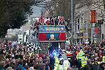 Swansea City Football team and fans celebrating during an open-top bus parade through the centre of Swansea after beating Bradford City 5-0 in Sunday's Capital One Cup final at Wembley to win the Capital Cup trophy.