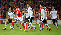 Gareth Bale of Wales (2nd L) dribbles his way past 4 Austria players during the FIFA World Cup Qualifier Group D match between Wales and Austria at The Cardiff City Stadium, Cardiff, Wales, UK. Saturday 02 September 2017