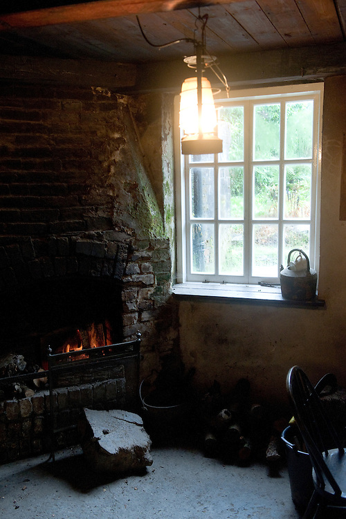 Open fire in the office of the head gardener, Heligan, Cornwall, mid February.