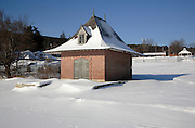 Brick building on the shore of Lake Winnipesaukee in Center Harbor, New Hampshire USA which is the largest lake in New Hampshire during the winter months.