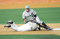 Sergio Leon (4) of the Marshall Thundering Herd can't handle a pick-off throw as Evan Stephens (5) of the Wake Forest Demon Deacons slides head-first into second base at Wake Forest Baseball Park on February 17, 2014 in Winston-Salem, North Carolina.  The Demon Deacons defeated the Thundering Herd 4-3.  (Brian Westerholt/Four Seam Images)
