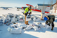 Longtime trail volunteers John Hooley and Randy Johnson sort through musher return bags at the Galena airport during the 2017 Iditarod on Friday afternoon March 10, 2017.<br /> <br /> Photo by Jeff Schultz/SchultzPhoto.com  (C) 2017  ALL RIGHTS RESERVED
