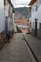 Peru, Cusco.  Street Scene Showing Traditional Inca Gutter in Middle of the Street, for Rainwater Run-off.