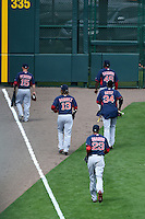 Boston Red Sox players Dustin Pedroia (15), Hanley Ramirez (13), Alexi Ogando (23), David Ortiz (34) and Pable Sandoval (48) leave the field during a Spring Training game against the Pittsburgh Pirates on March 12, 2015 at McKechnie Field in Bradenton, Florida.  Boston defeated Pittsburgh 5-1.  (Mike Janes/Four Seam Images)