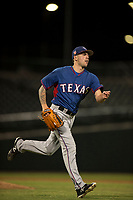 AZL Rangers starting pitcher Joe Palumbo (21) flips the ball to first base in a rehab start during an Arizona League game against the AZL Cubs 2 at Sloan Park on July 7, 2018 in Mesa, Arizona. AZL Rangers defeated AZL Cubs 2 11-2. (Zachary Lucy/Four Seam Images)