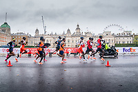 4th October 2020, London, England; 2020 London Marathon; The leading group in the Elite Men's Race passes Horse Guards Parade. The historic elite-only Virgin Money London Marathon taking place on a closed-loop circuit around St James's Park in central London on Sunday 4 October 2020.