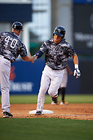 Tampa Yankees center fielder Trey Amburgey (17) is congratulated as he rounds third base after hitting a home run in the bottom of the fourth inning during a game against the Bradenton Marauders on April 15, 2017 at George M. Steinbrenner Field in Tampa, Florida.  Tampa defeated Bradenton 3-2.  (Mike Janes/Four Seam Images)