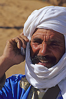 Near Erfoud, Morocco - Berber Using his Cell Phone.